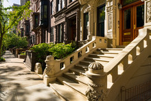 Brownstones With Doorsteps And Ornament In Morning Light. Upper West Side Street, Manhattan, New York City