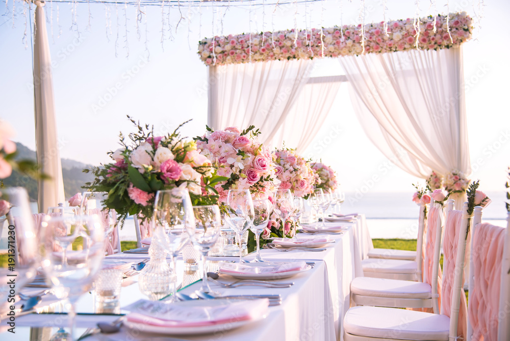 Fototapeta Table setting at a luxury wedding and Beautiful flowers on the table.