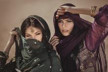 Arabian Woman Traveling In Desert.