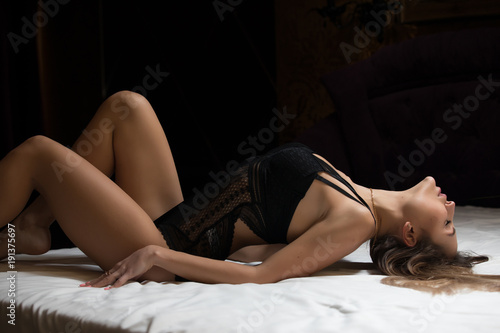 Fotografie, Obraz  Sexy attractive model lying on a bed in lingerie