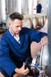 Man working on secondary fermentation equipment