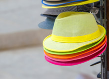 Colorful Hats In Outdoor Store Stacked In A Rows.  Varied Fashion Hats Showcase  Market Shop.