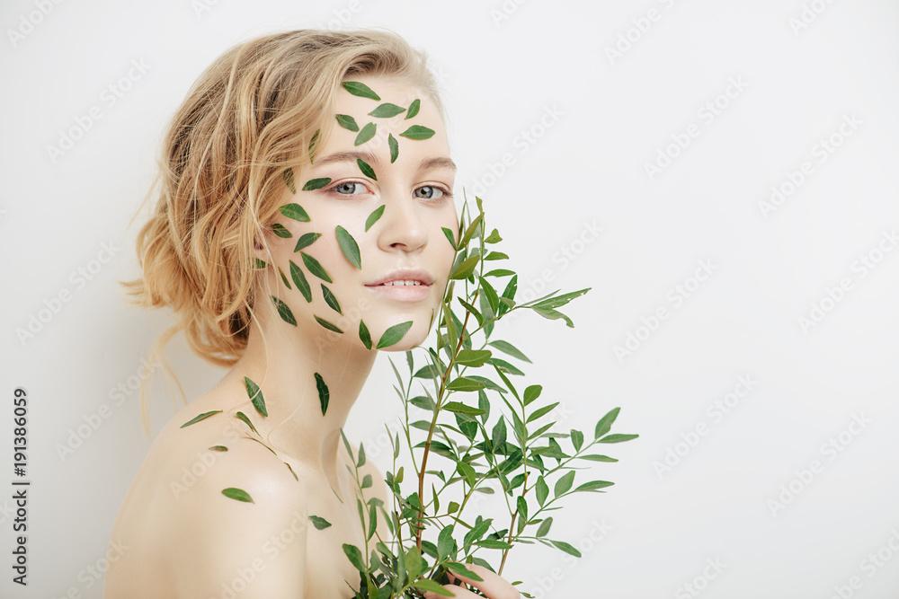Fototapeta green leaves on face