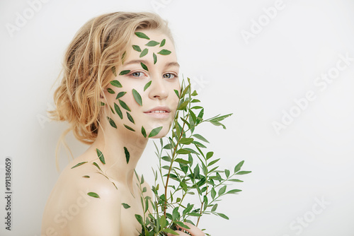 green leaves on face