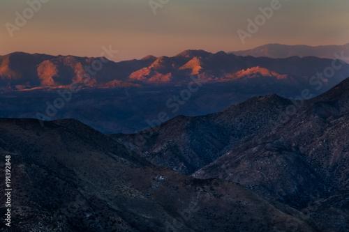 sunset on desert mountains Plakat