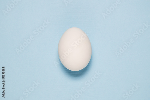 Cuadros en Lienzo Top view of white egg isolated on pale blue background.