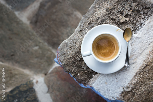 Wall Murals Coffee beans White cup of coffee, outdoors.