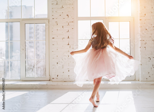 Cute little girl in dress Wallpaper Mural