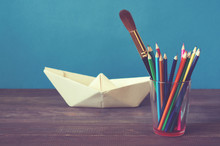 Colored Pencils, Paper Boat An...