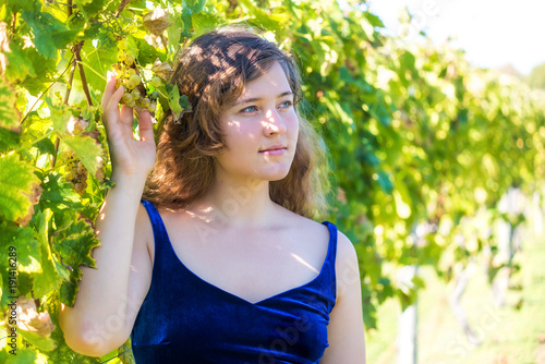 Closeup Portrait Of Elegant Young Woman S Face By Vineyard
