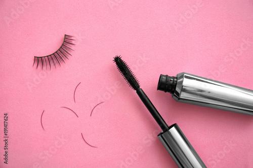 Valokuva  Mascara and false eyelashes on color background