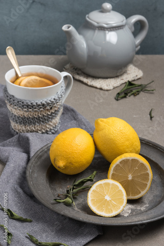 Spoed Foto op Canvas Chocolade Cup of tea with lemon on table close-up. Healthcare traditional medicine and flu treatment concept.