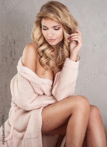 Sensual blonde woman posing. Wall mural