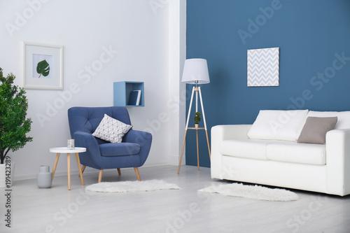 Fotografía  Trendy room interior with modern color armchair