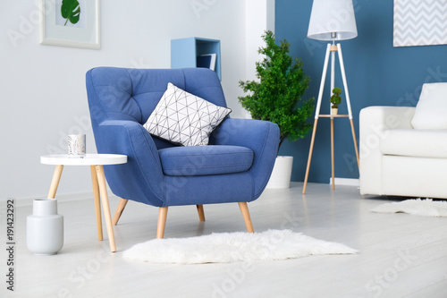 Trendy room interior with modern color armchair Canvas Print