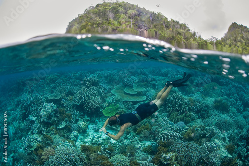 Snorkeler and Shallow Reef in Raja Ampat