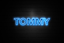 Tommy Neon Sign On Brickwall