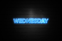 Wednesday Neon Sign On Brickwall