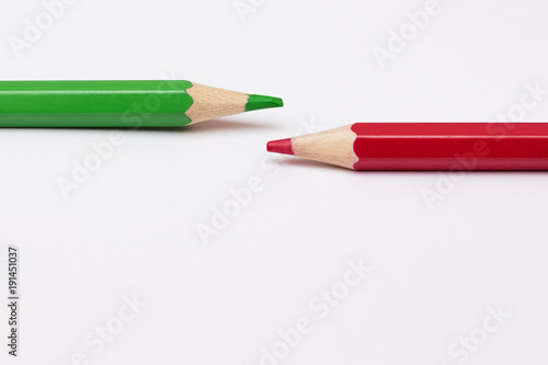 Photo two pencils of green and red, symbolize the opposite