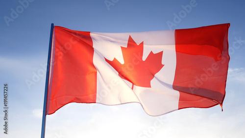 Canada flag on clear blue sky