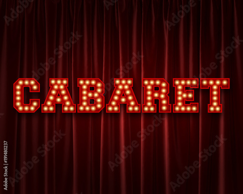 Photo  Cabaret lightbulb lettering word against a red theatre curtain