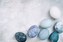 Eggs With Marble Stone Effect On Grey Concrete Background With Copy Space