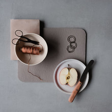 Overhead View Of Half Apple On Plate With Scissors And Spool On Table