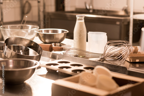 close up view of ingredients for dough and kitchen utensils on counter in restau Canvas Print