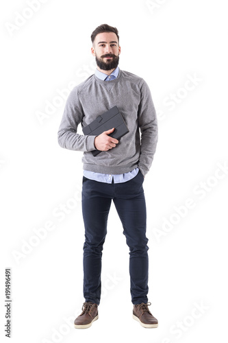 Smiling happy bearded businessman holding planner looking at camera. Full body length portrait isolated on white studio background.
