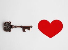Key To Your Heart, Open And Unlock Your Heart, Valentine's Day Concept, Vintage Key And Red Heart Made From Paper On White Paper Background, Eternal Love, Negative Space For Text