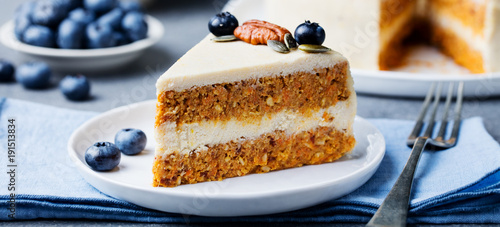 Photo  Vegan, raw carrot cake on a white plate. Healthy food.
