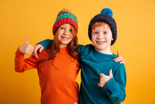 Funny Little Children Wearing Warm Hats Showing Thumbs Up.
