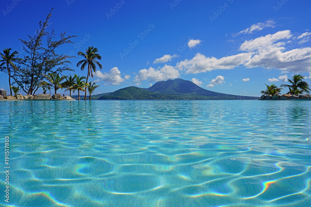 Fototapeta View of the Nevis Peak volcano from a swimming pool in Christopher Harbour, St Kitts
