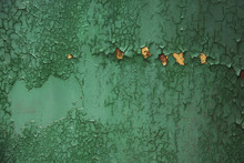 Grunge, Vintage. Closeup Of An Old Green Painted Sheet Iron, Metal Door With Peeling Paint And Rust.