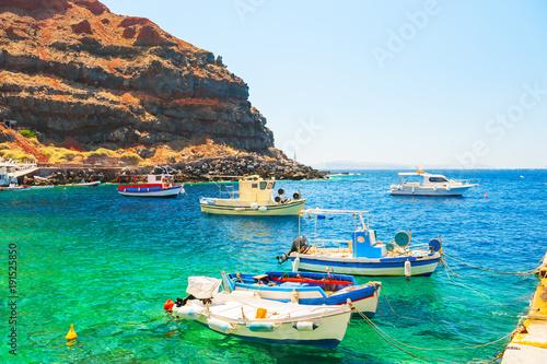Traditional greek boats in the port of Santorini island, Greece.
