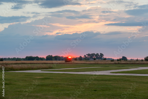 Photo Suset over the airfield