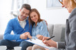 Young couple with psychologist family therapy therapist writing diagnosis close-up