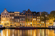 Canals and tradition house in Amsterdam at night. Amsterdam is the capital and most populous city of the Netherlands.