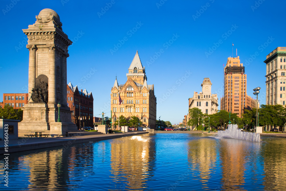 Fototapety, obrazy: Downtown Syracuse New York with view of historic buildings and fountain at Clinton Square