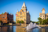 Fototapeta Nowy Jork - Downtown Syracuse New York with view of historic buildings and fountain at Clinton Square