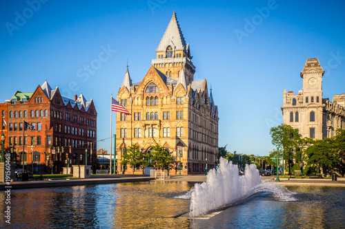 Downtown Syracuse New York with view of historic buildings and fountain at Clint Canvas Print