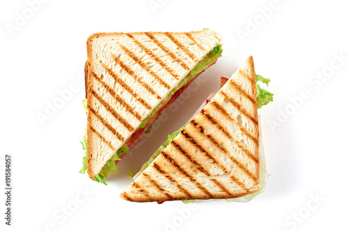 Staande foto Snack Sandwich with ham, cheese, tomatoes, lettuce, and toasted bread. Top view isolated on white background.