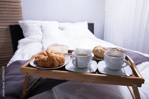Croissants And Cup Of Tea On Bed Wallpaper Mural