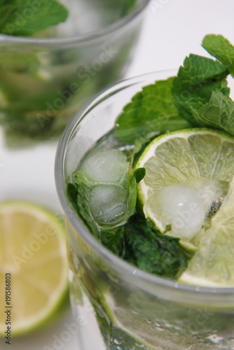 Fototapeta Summer Cocktail Mohito Mint and Lime Refreshing Drink Mojito with Rum and Ice in Glass Isolated. obraz na płótnie