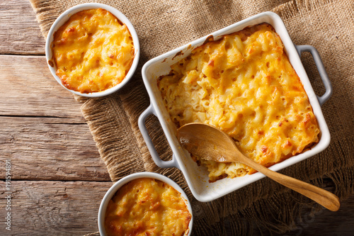 American casserole macaroni and cheese in baking dish close up. Horizontal top view