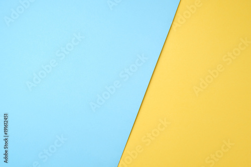Fotografia  blue and yellow pastel paper color for background