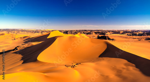 Sunset view to Tin Merzouga dune at Tassili nAjjer national park in Algeria