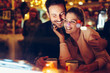 canvas print picture - Romantic couple dating in pub at night
