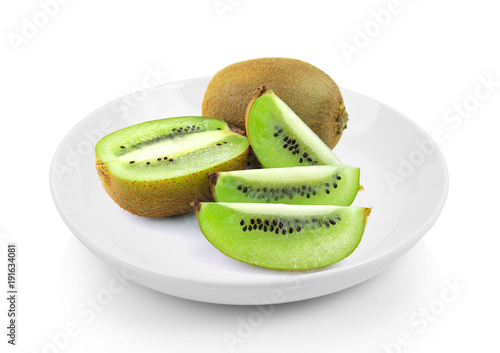 Juicy kiwi fruit in plate on white background