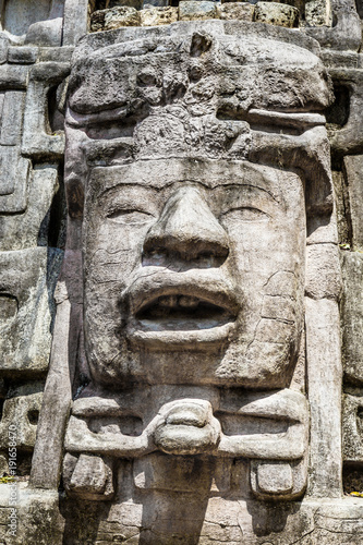 Photo Old ancient stone Mayan pre-columbian civilization carved face and ornament, Lam